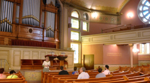 A tour happening in the original edifice of The Mother Church