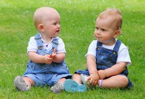 Image of two babies talking