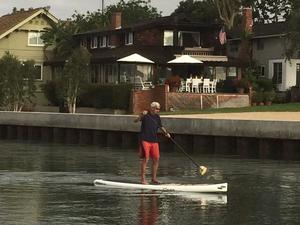 A person paddleboarding