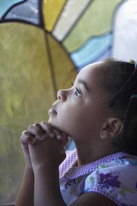 A girl praying in church